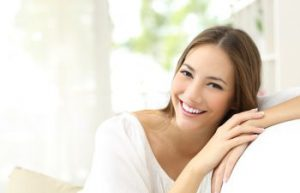 smiling woman sitting on a couch