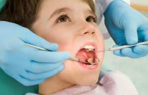 child during teeth examination