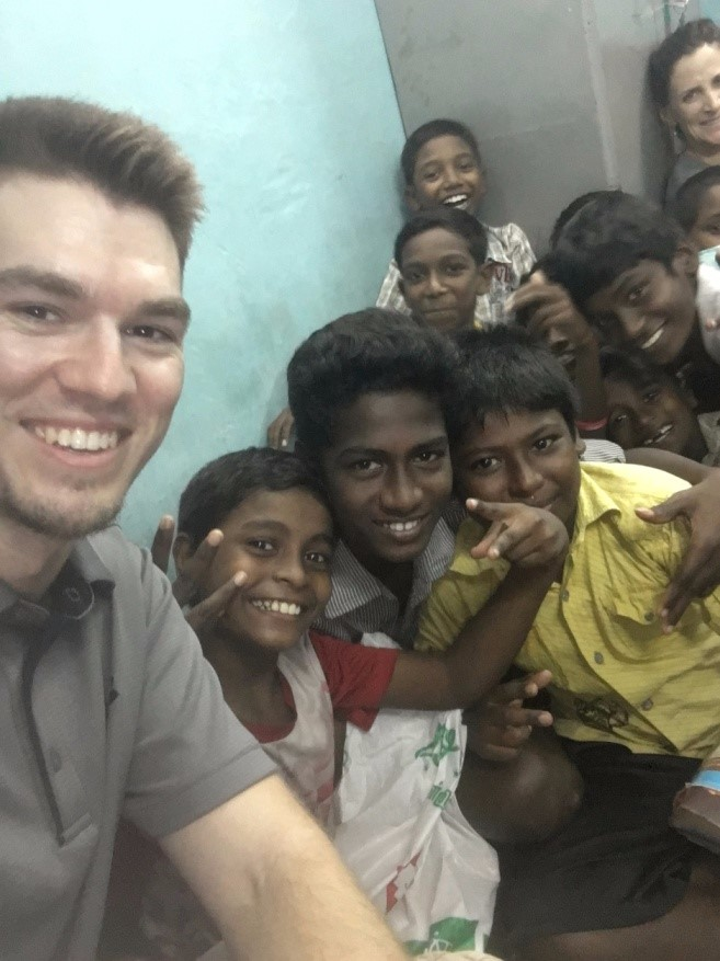 Dr. Paul Gannon helping children in Aftica