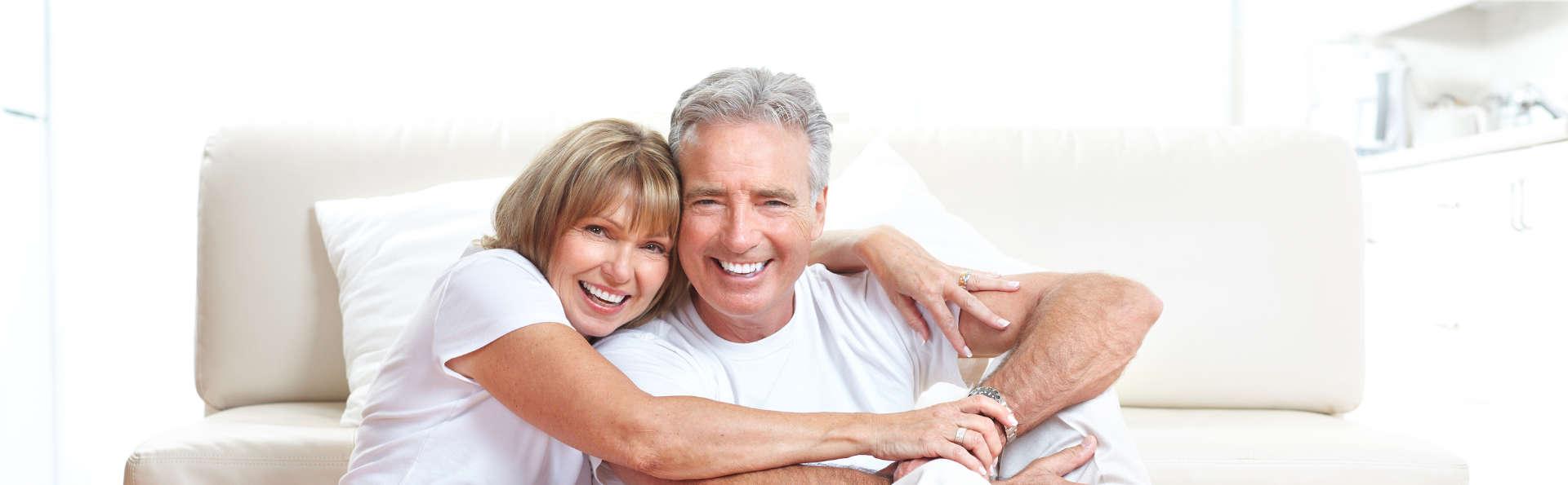 hugging smiling couple