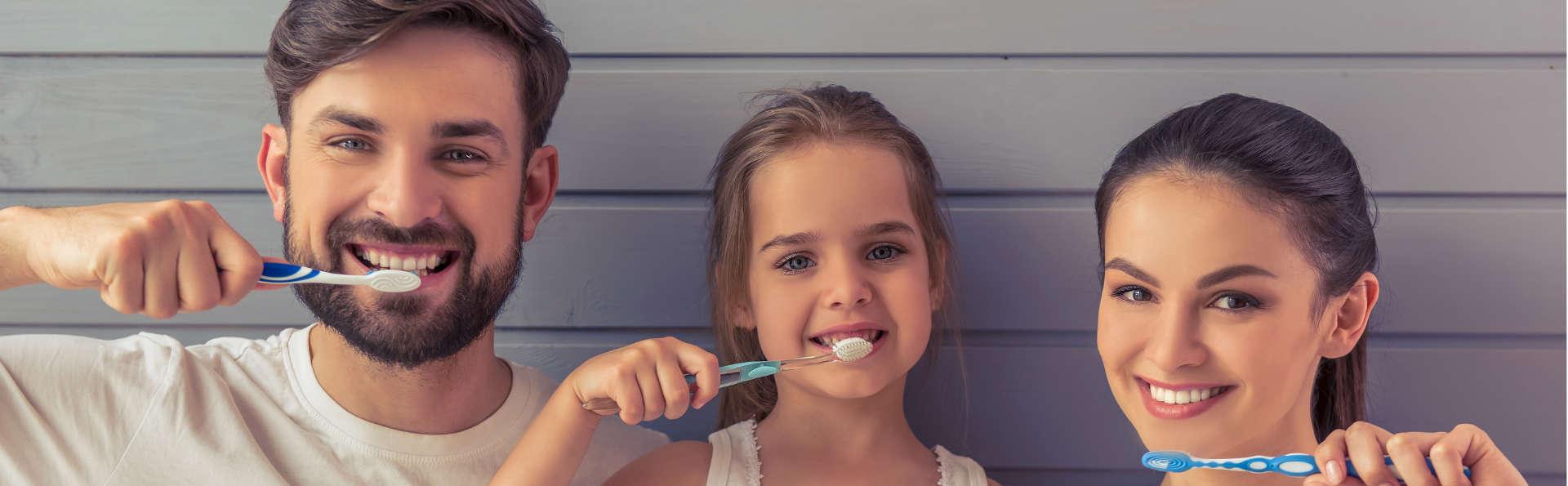 smiling family brushing teeth