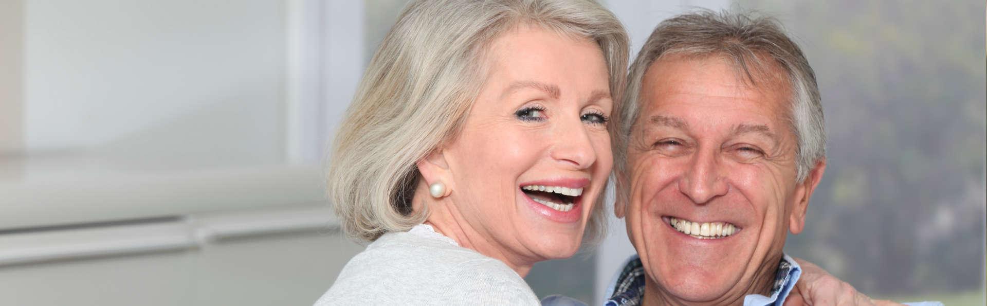 smiling elderly couple