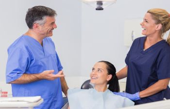 Dentist and Assistant Discussing Treatment with Patient Gainesville, GA